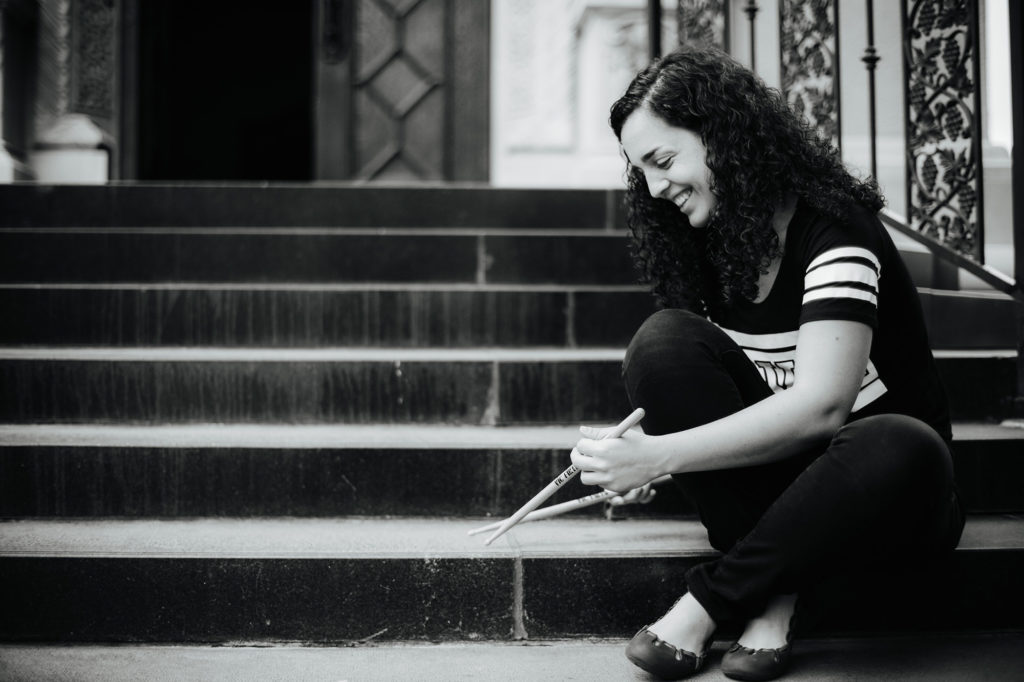 Ana Barreiro playing on a step with her drum sticks