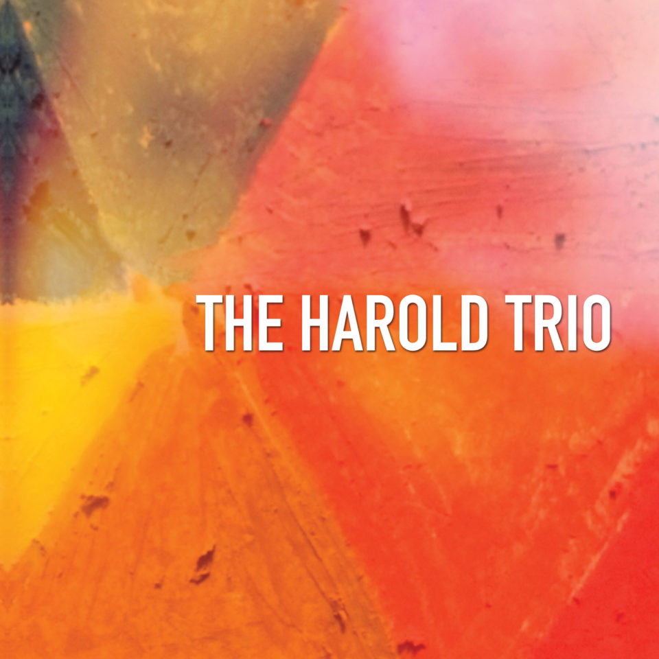 CD cover: triangles colored in red, orange, blue, yellow, and purple